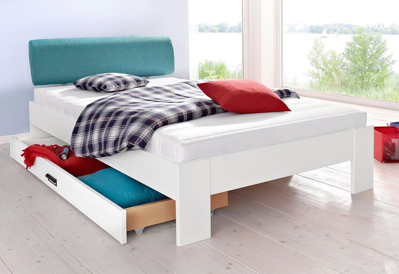 Matraflex futonbed met een zacht bekleed hoofdbord