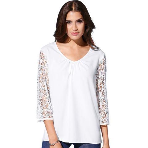 Création L NU 15% KORTING: Creation L blouse met elegante, lage V-hals