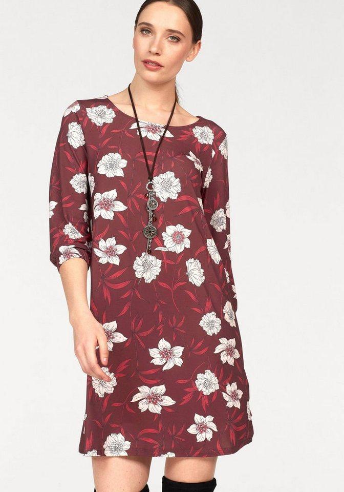Laura Scott gedessineerde jurk rood