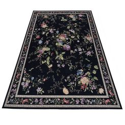 theko vloerkleed flomi sagrini platweefsel, pastelkleuren, bloemen design, woonkamer zwart