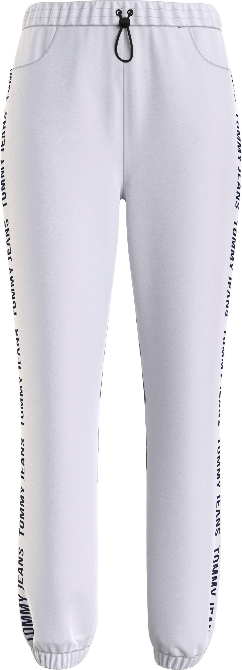 TOMMY JEANS joggingbroek TJW JOGGER TAPE RELAXED met tommy jeans-logo-opschrift opzij op de pijpen nu online bestellen